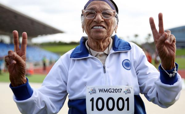 Centenarian Man Kaur of India celebrates after competing in the 100-meter sprint in the 100+ age category at an international event in Auckland on April 24, 2017.