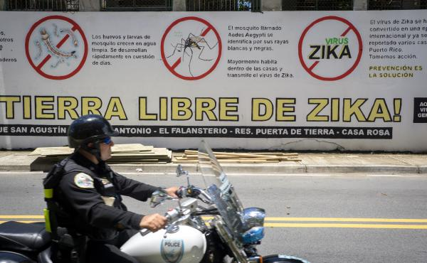 Anti-Zika advice applied to a wall in front of a housing project in the Puerta de Tierras section of San Juan, Puerto Rico. This public health message was part of an island-wide effort to stem the spread of Zika.