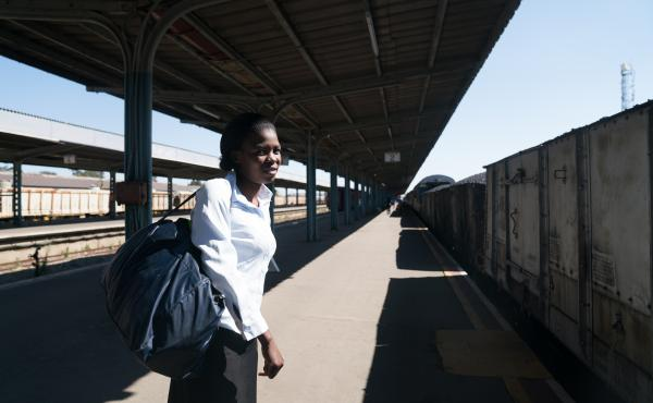 "Sidumiso Nyoni, 30, took the train from her home in rural Nyamandhlovu, Zimbabwe, to the industrial city of Bulawayo to visit family. ""The train doesn't have a specific time at which it comes,"" she says."