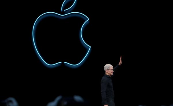 Apple CEO Tim Cook delivers the keynote address at the 2019 Apple Worldwide Developers Conference in San Jose, Calif., on Monday. The company announced that it's breaking up the iTunes application into three apps handling music, podcasts and TV.